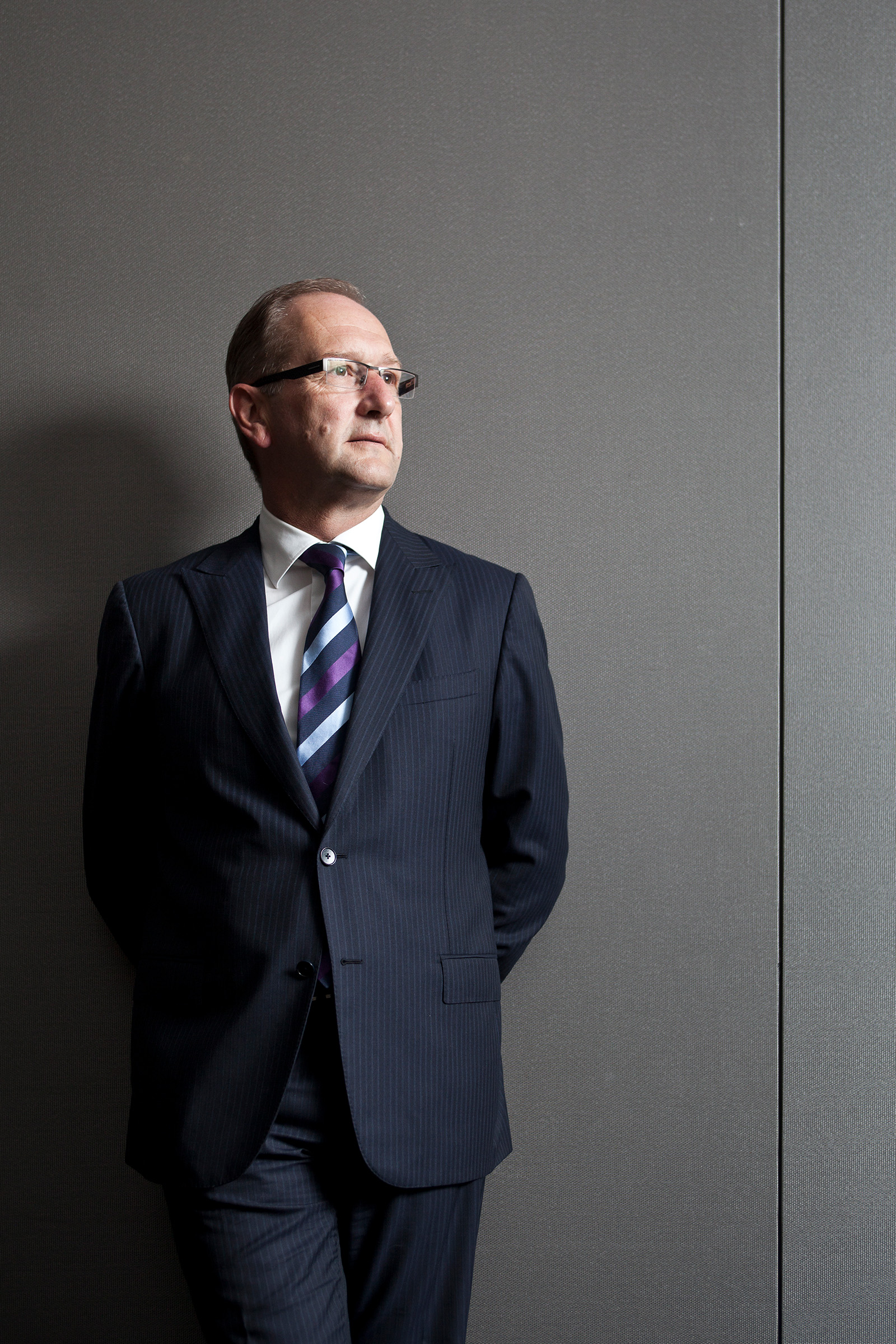 Corporate editorial location portrait CEO photography Anthony Day Suncorp blue suit looking off camera