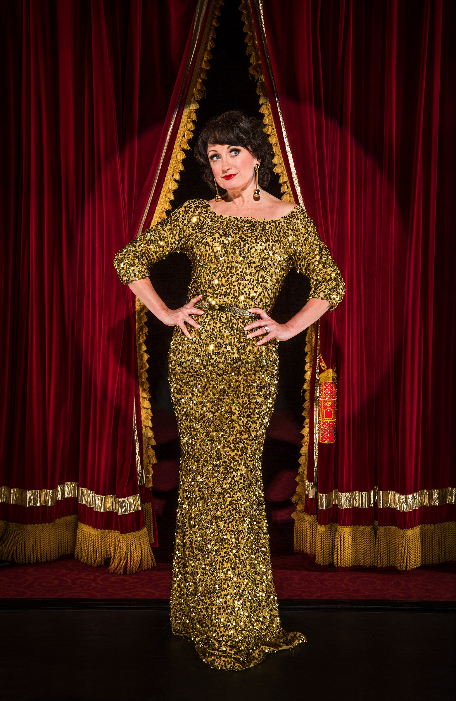 Editorial location photography entertainer Caroline O'Connor on stage sparkle dress