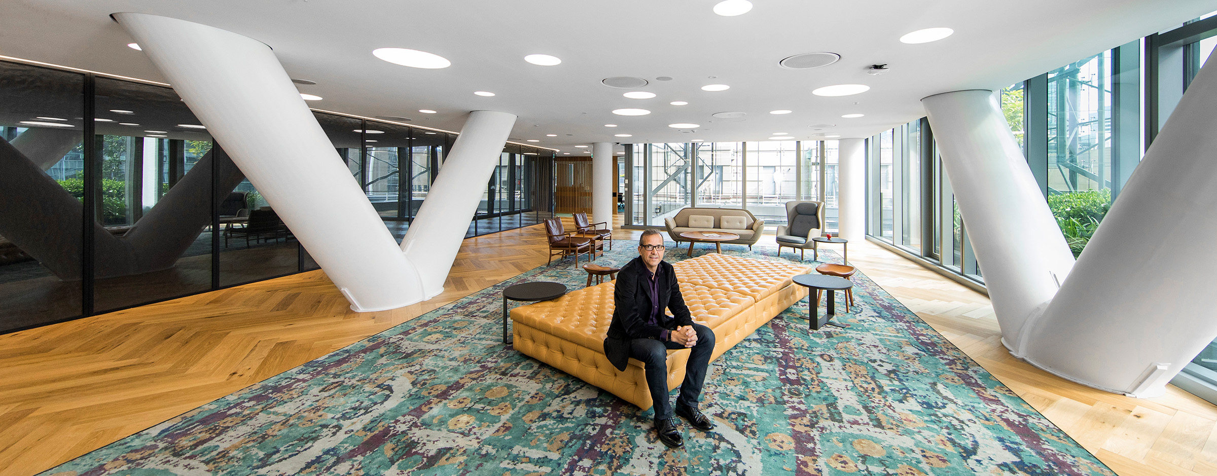 Editorial location photography for Engineers Australia of Tony Lavarto sitting in Ashurst reception Sydney