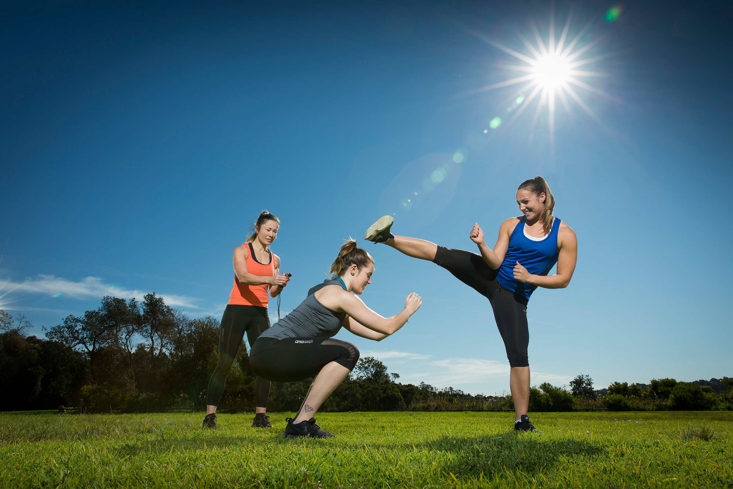 Editorial location fitness photography for Fitness Australia of 3 women group training session at a park