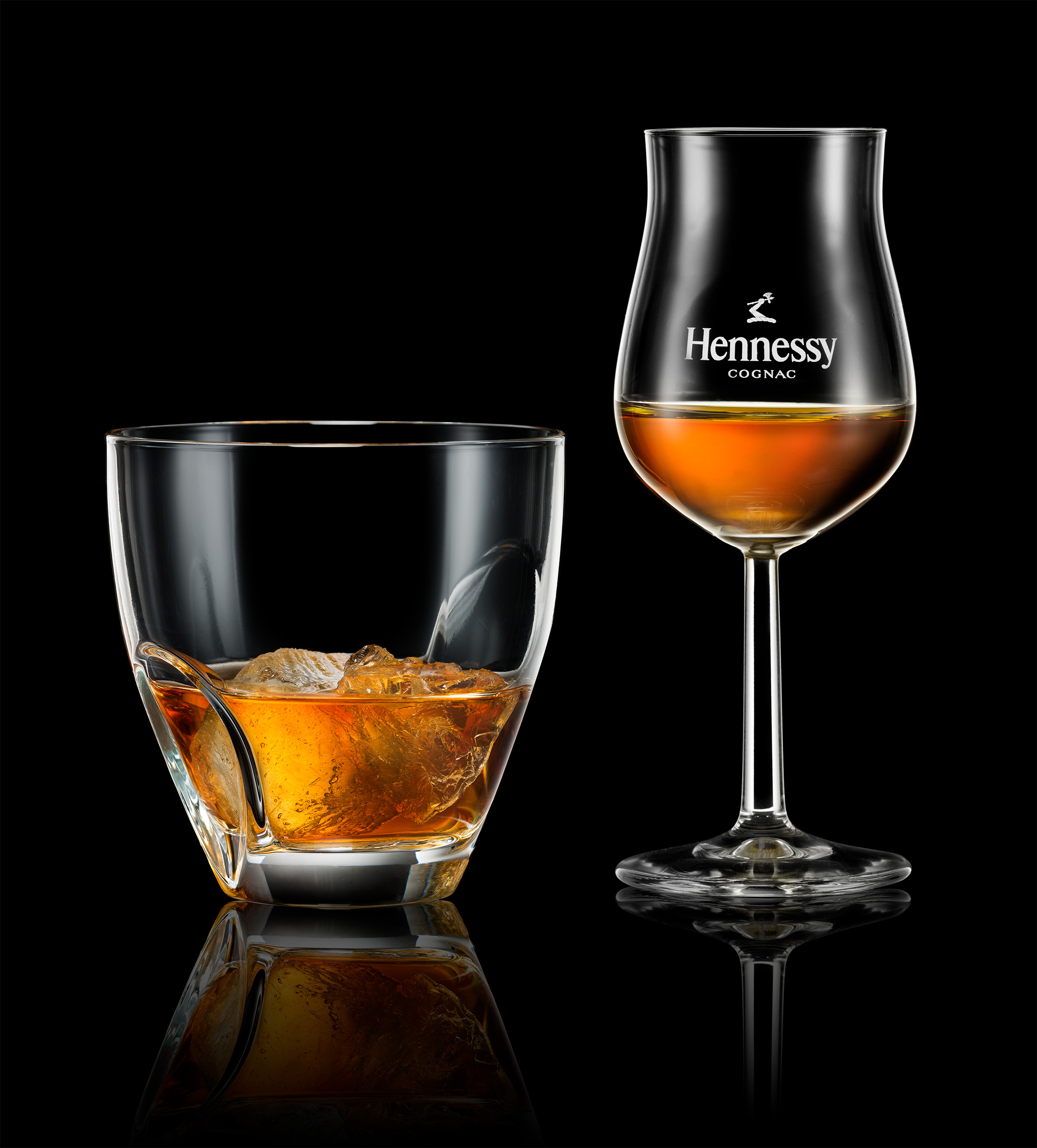 Advertising studio alcohol photography of Hennessy cognac liquor in glass with ice