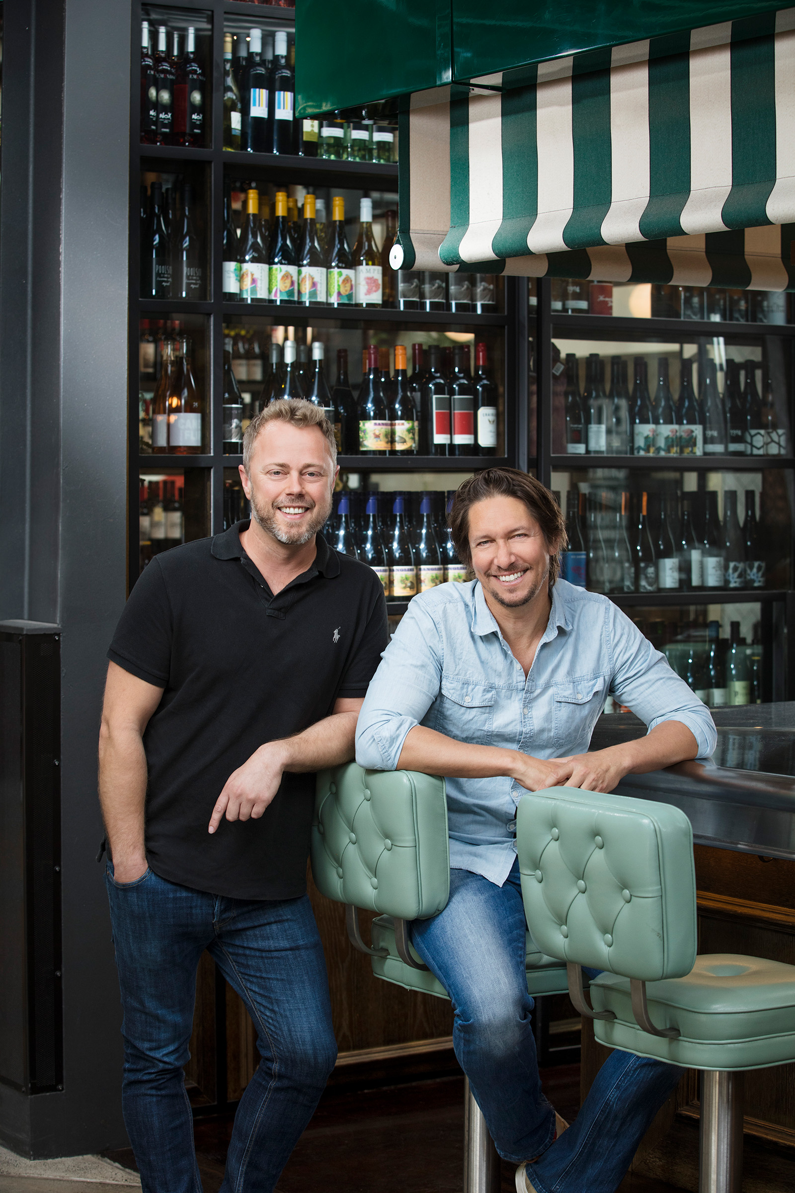 Editorial location photography for Inside Retail of Vinomofo founders Andre Eikmeier and Justin Dry smiling at the camera