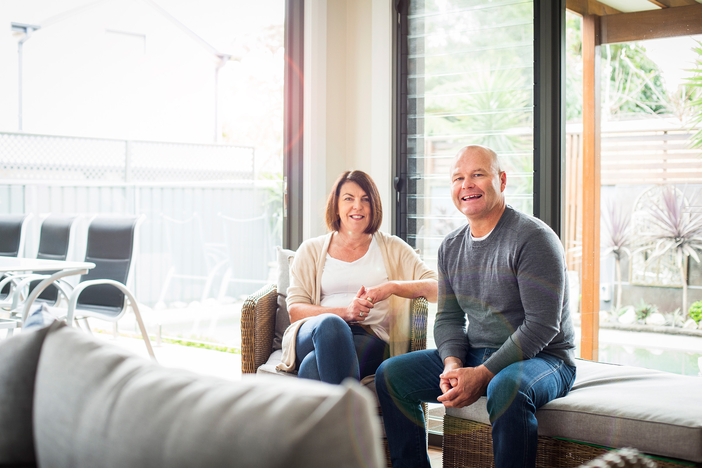 Advertising editorial location photography for NIB husband wife couple seated at home