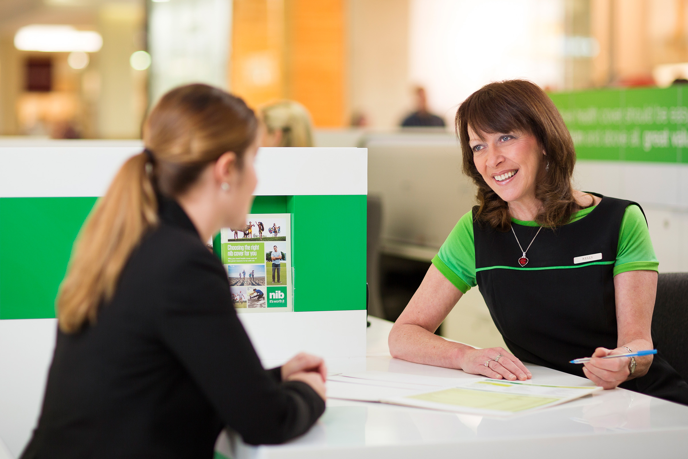 Advertising editorial location photography of friendly NIB employee talking to customer
