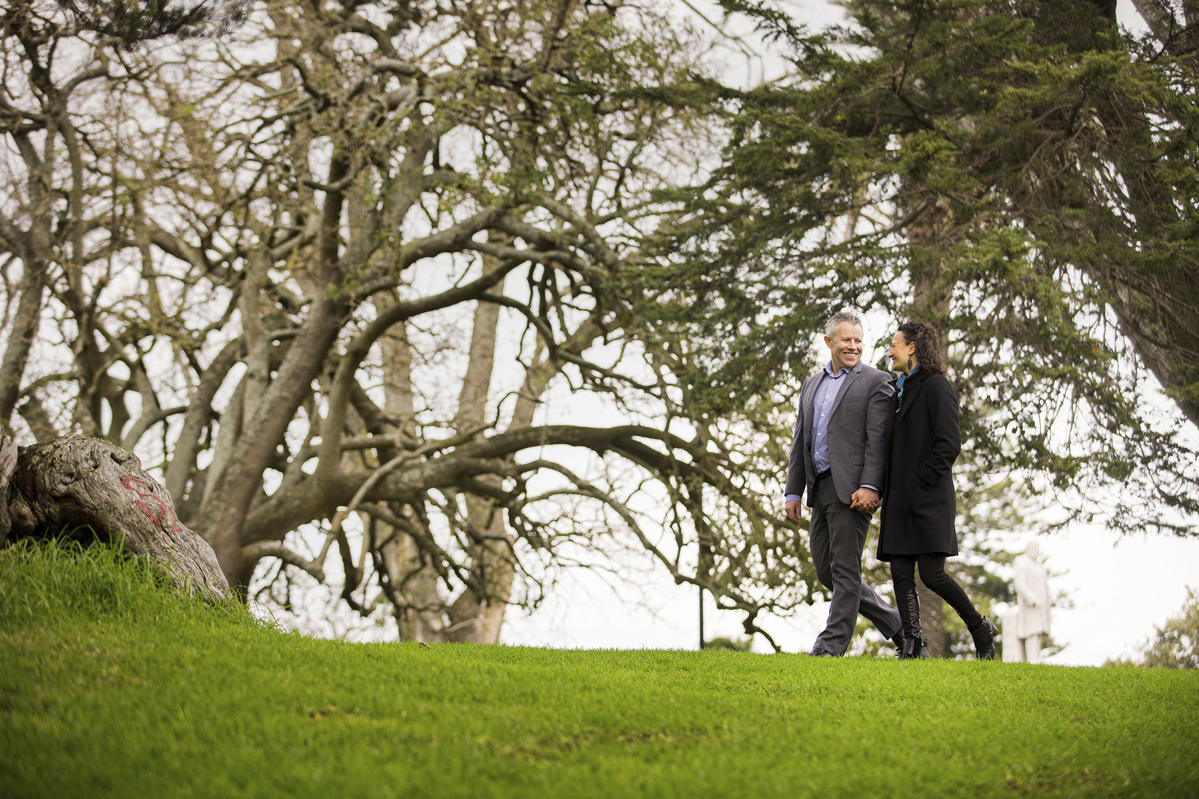 Editorial lifestyle annual report photography for NIB of a smiling man and woman holding hands walking in the park