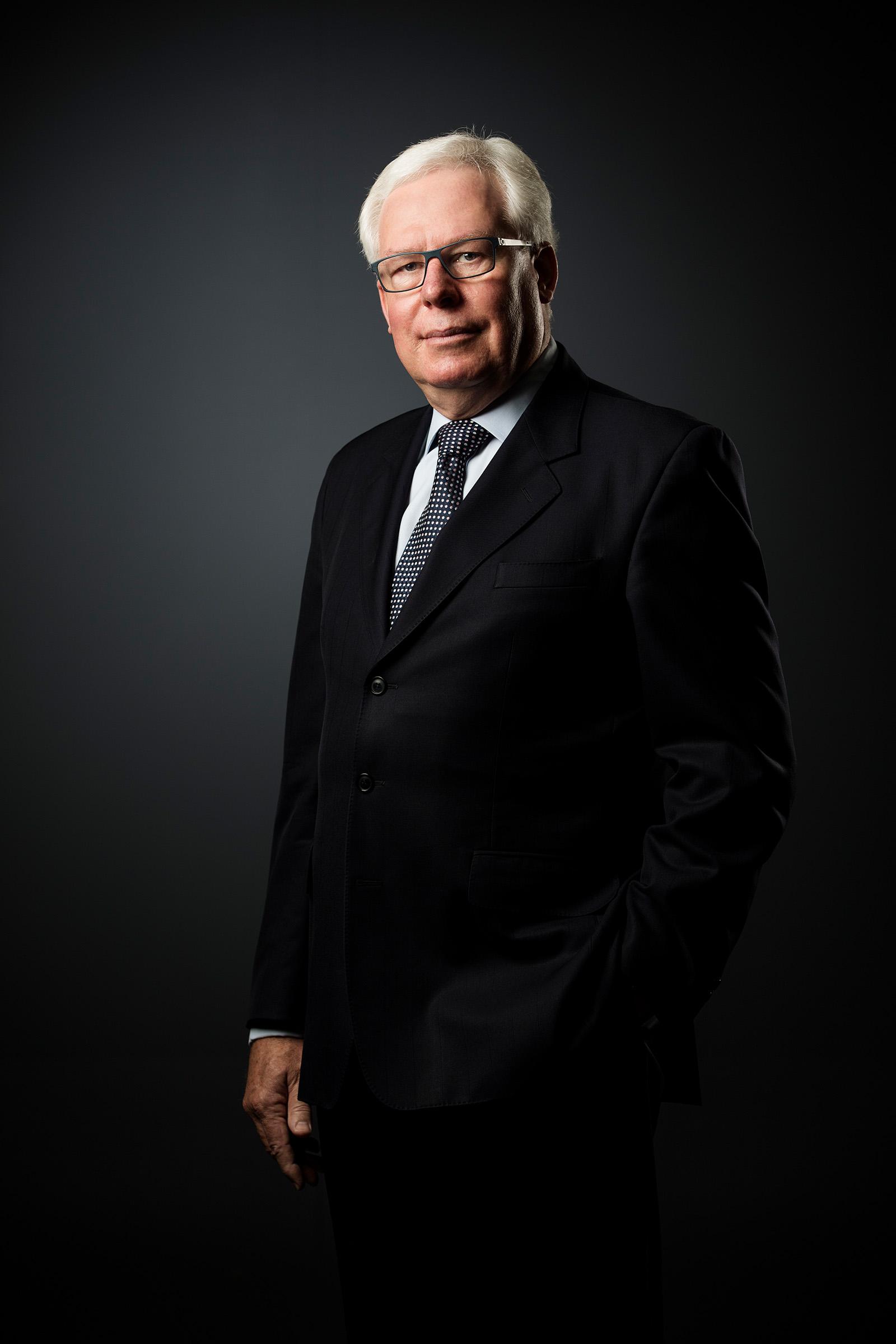 Corporate studio CEO photography Dallas Booth NIBA hand in pocket grey background