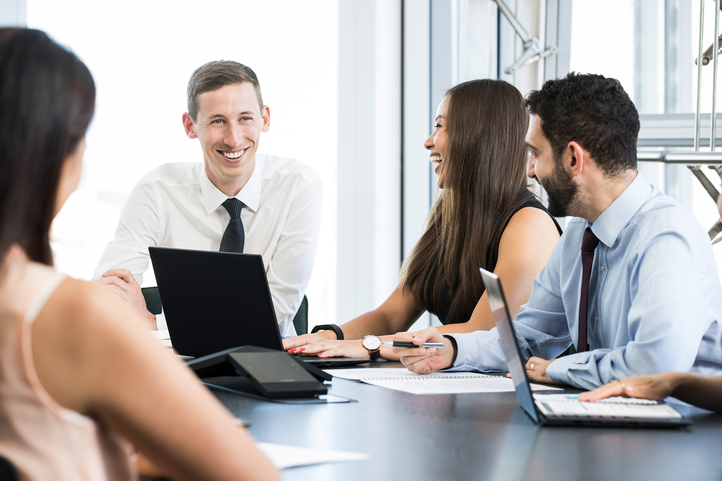 Corporate website working group photography 2 females 2 males seated office background