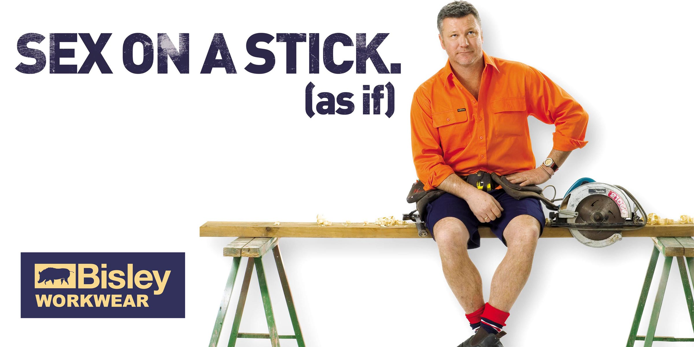 workman sitting on plank of wood on trestles