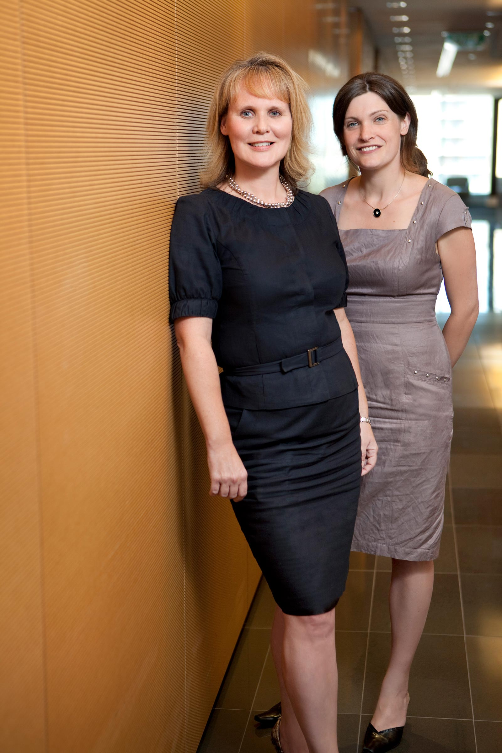 two female colleagues in hallway of corporate office