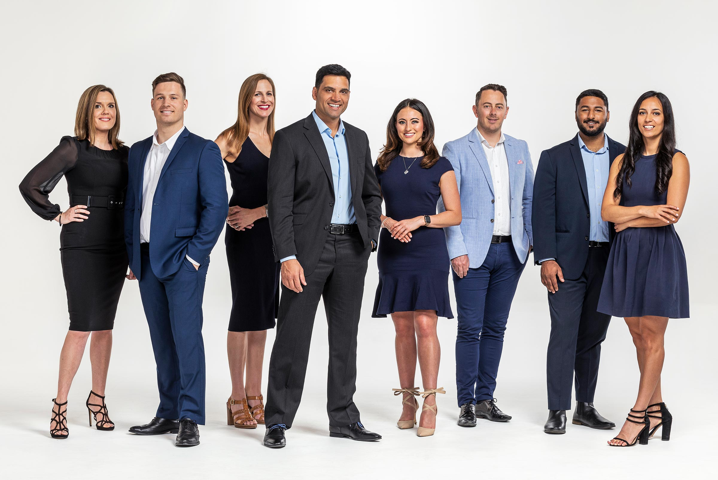 Corporate studio group shot photography List Ready MoneyMe 8 people white background