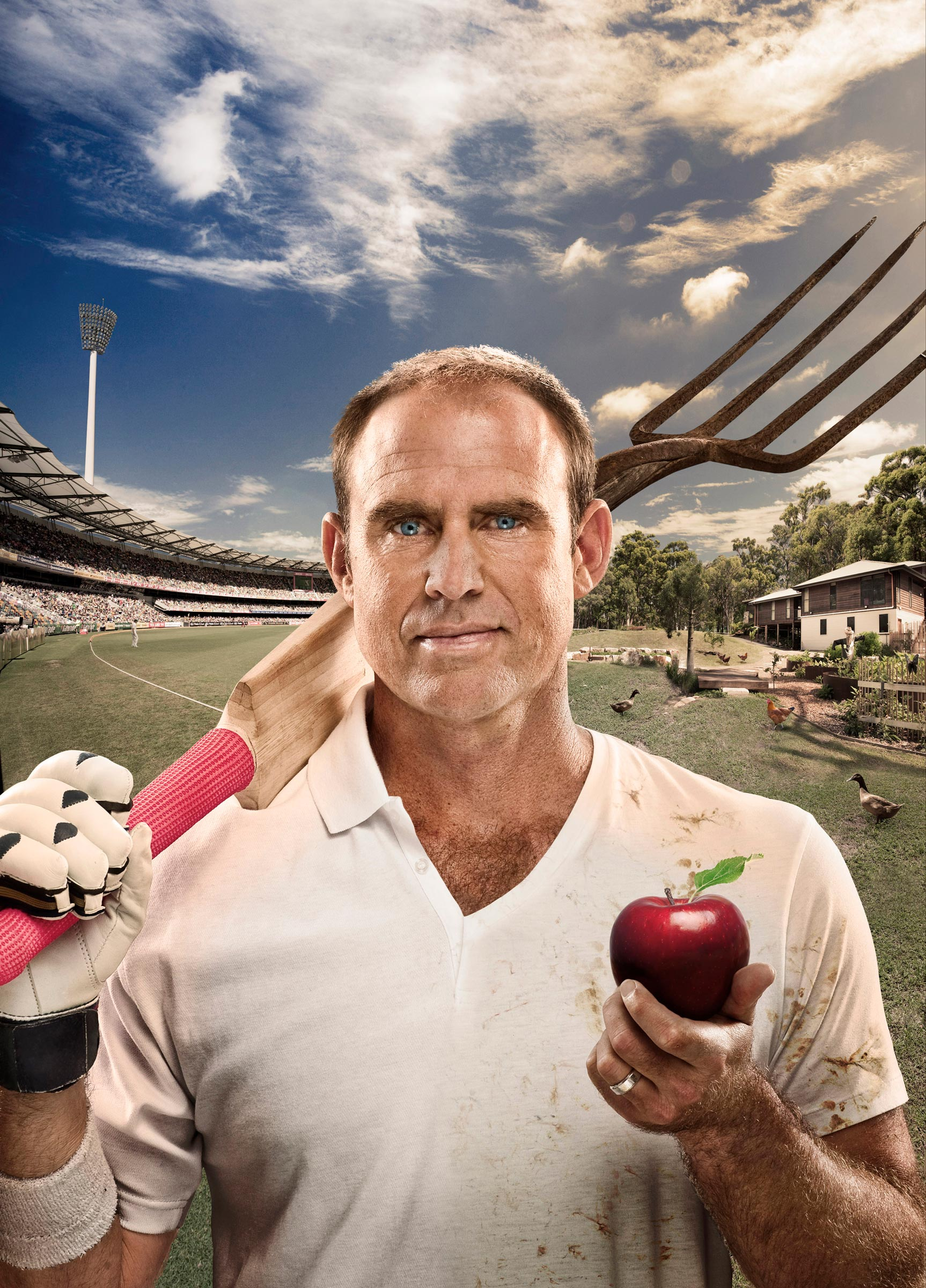 matthew hayden holding cricket bat and apple with cricket ground and farm in background
