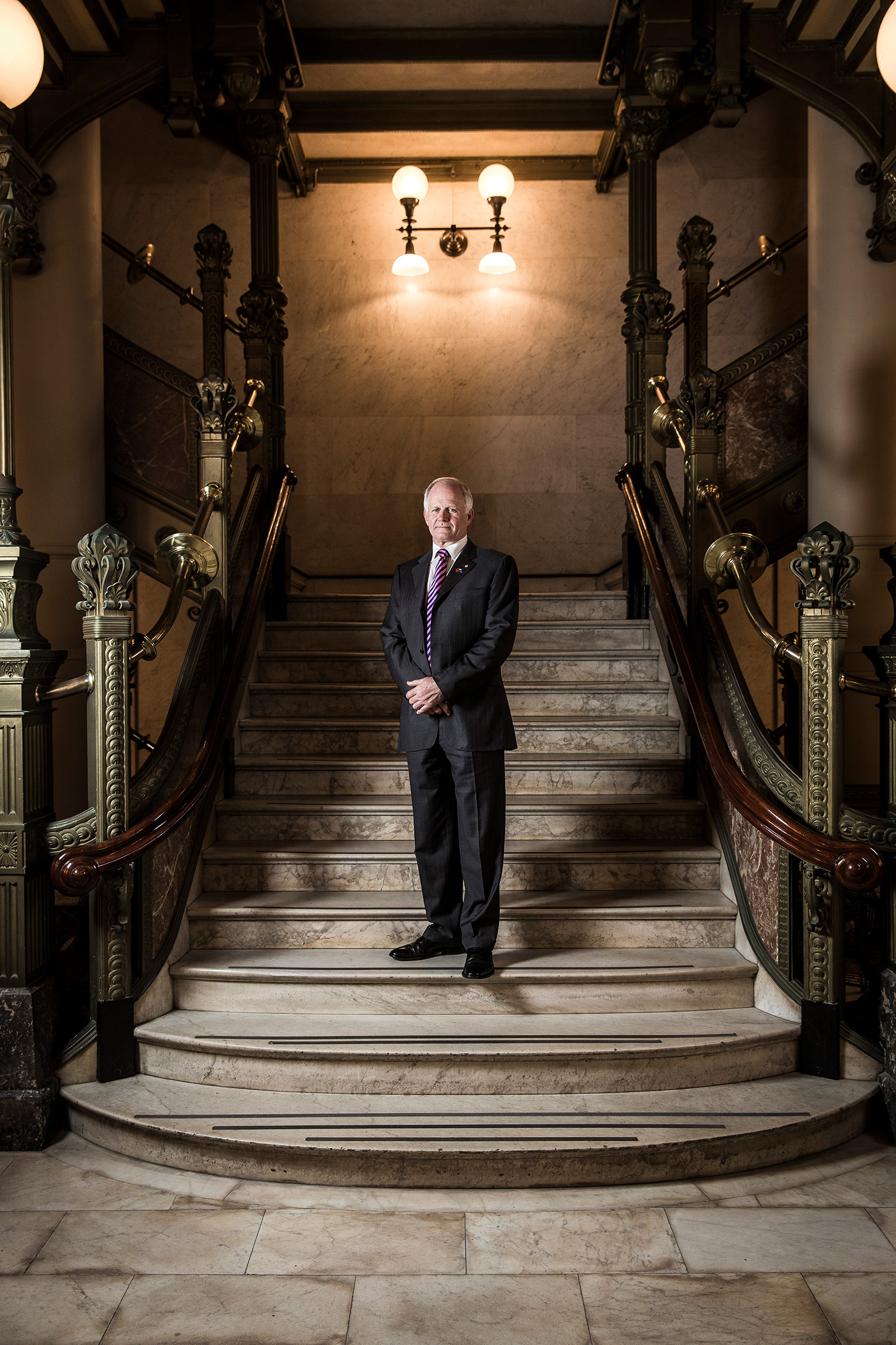 corporate male in historical building ornate staircase