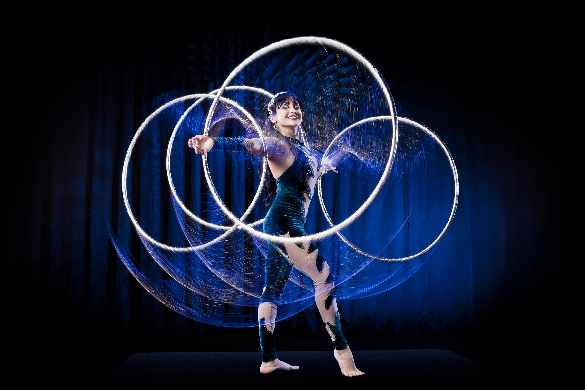 performer twirling hula hoops on stage
