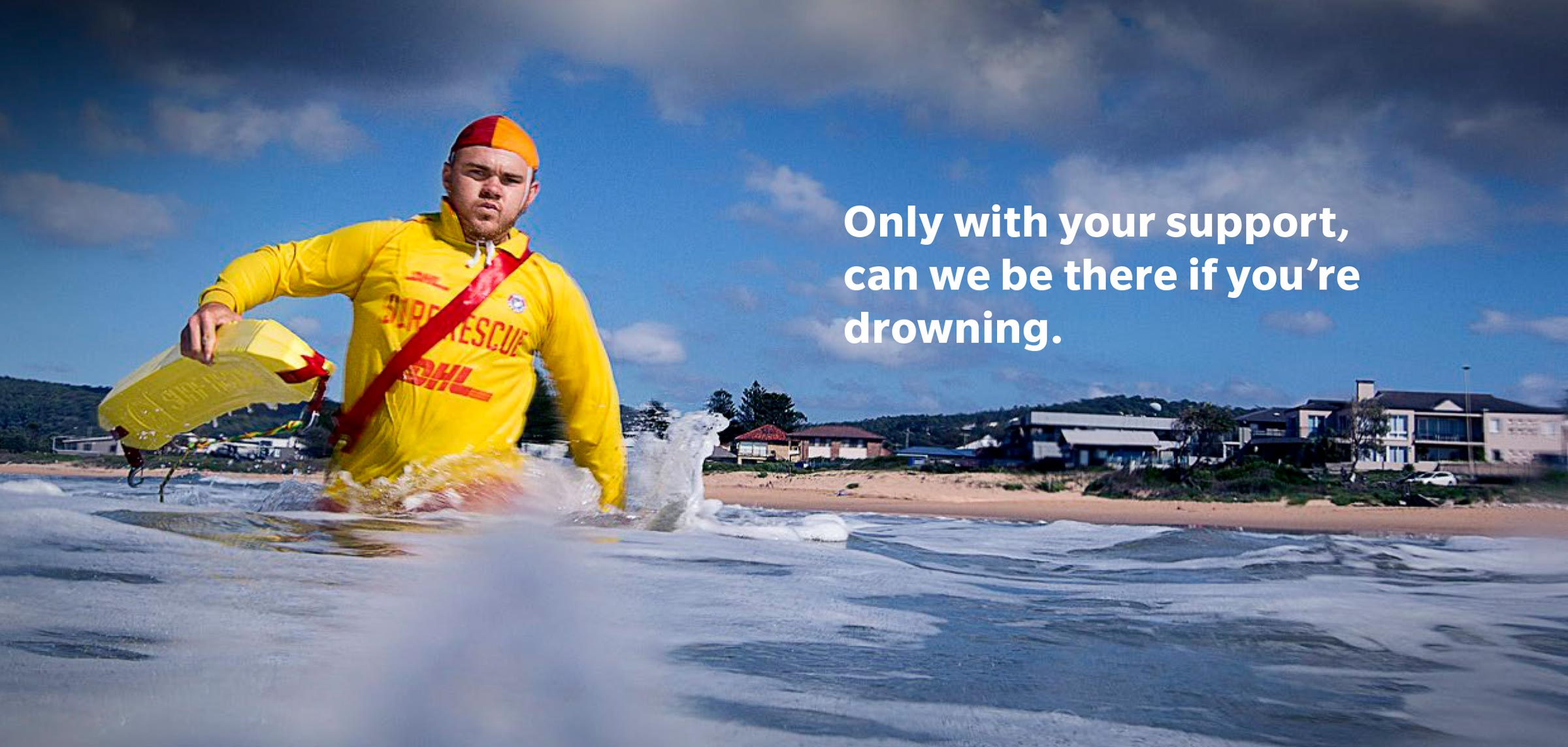 lifeguard coming to the rescue in the surf