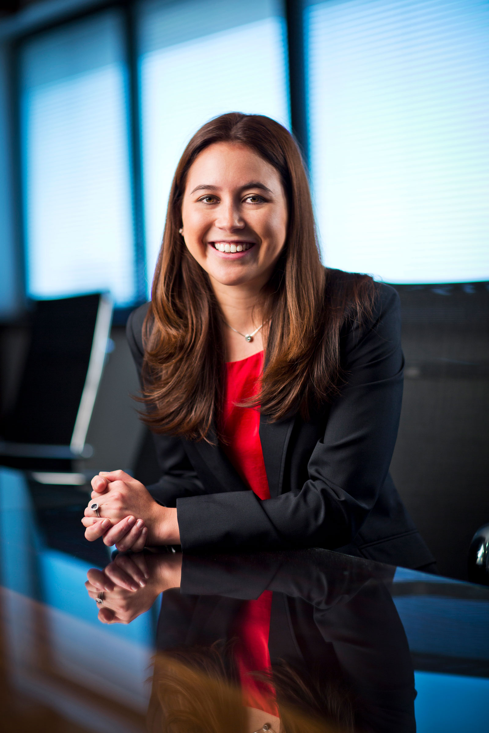 Corporate location lawyer photography Harmers Lawyers female smiling seated boardroom