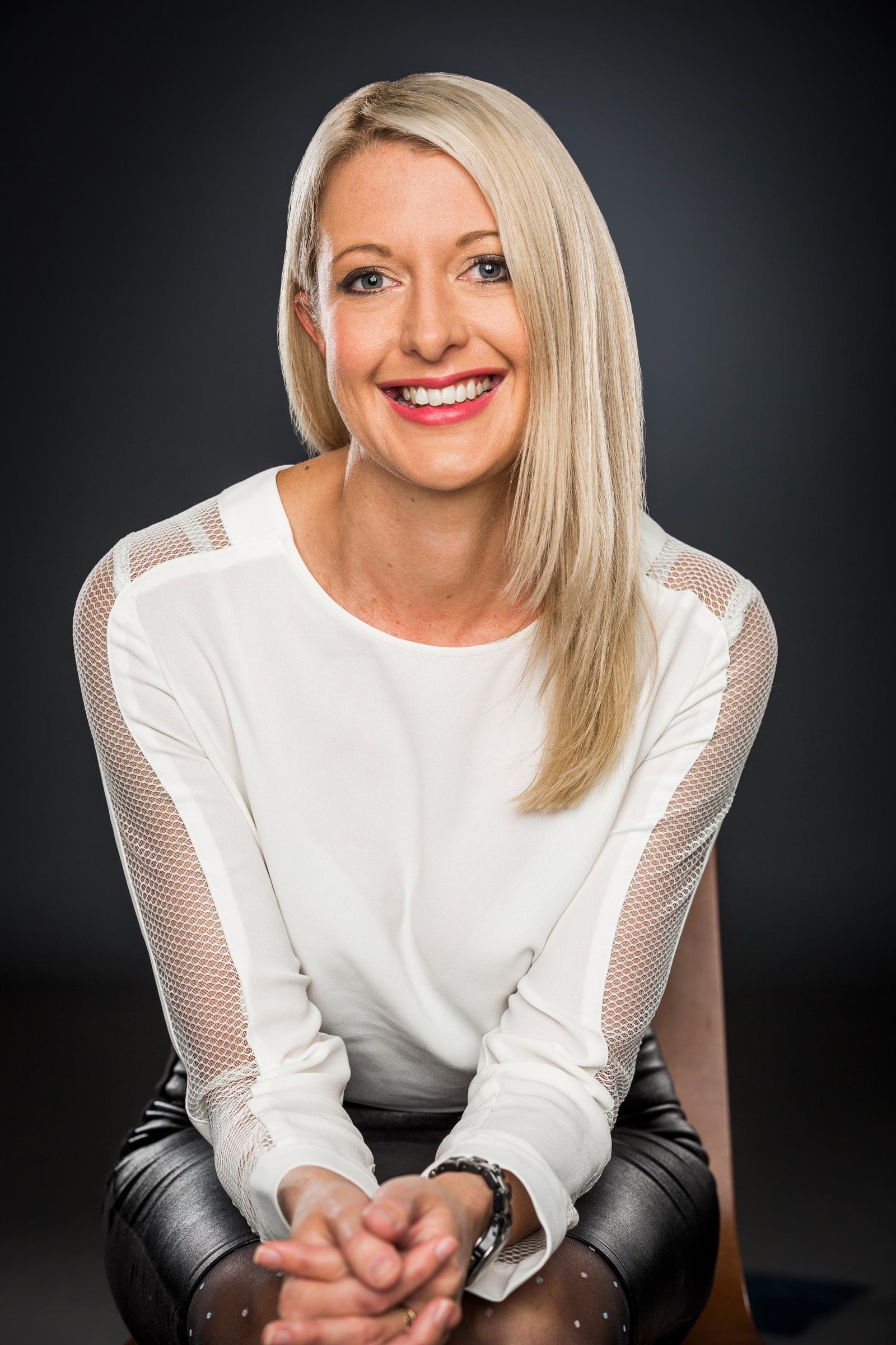 blonde female smiling in studio portrait