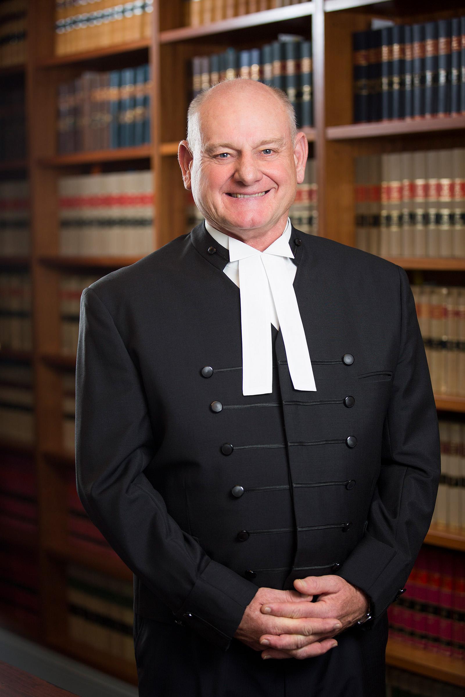 Corporate environmental barrister portrait photography Scot Wheelhouse SC Sir Anthony Mason Chambers bookcase background